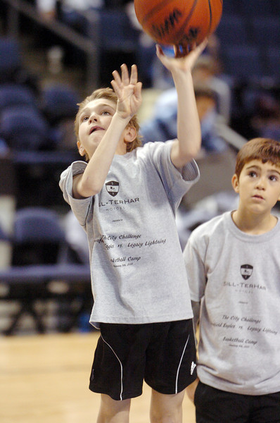 Joshua Humphrys, 8, shoots the ball during the basketball clinic before Saturday's Broomfield  Vs. Legacy girls and boys games at the 1stBank Center.<br /> January 8, 2011<br /> staff photo/David R. Jennings