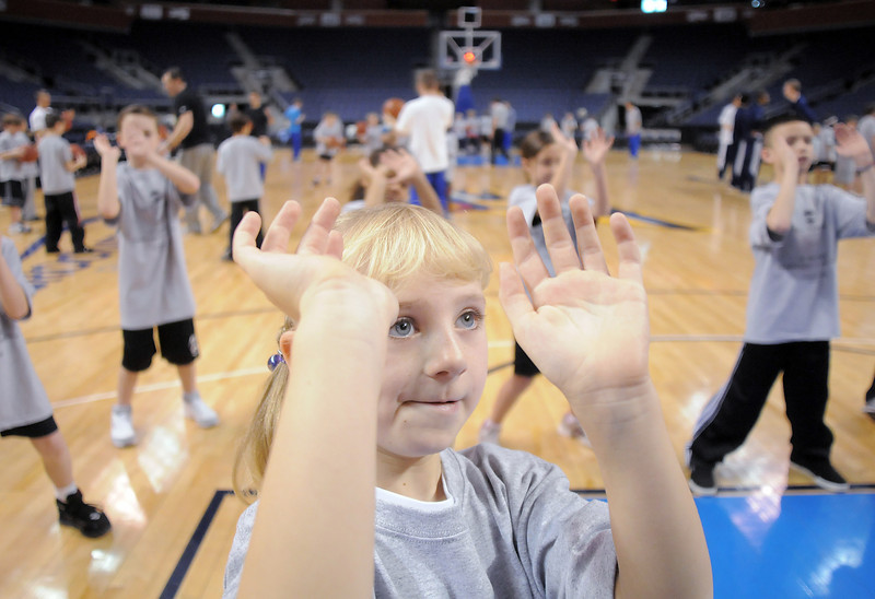 Kara Zila, 9, learns the proper postion of the hands for shooting a basketball during the basketball clinic before Saturday's Broomfield  Vs. Legacy girls and boys games at the 1stBank Center.<br /> January 8, 2011<br /> staff photo/David R. Jennings