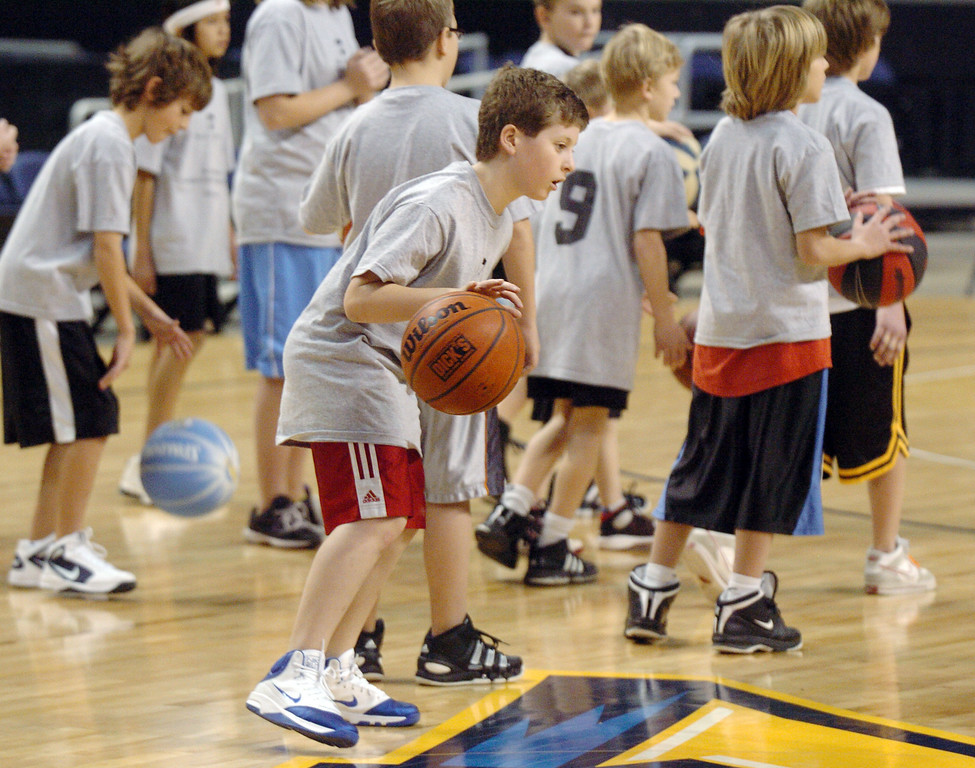 Cameron Swift, 9, practices dribbling the ball during the basketball clinic before Saturday's Broomfield  Vs. Legacy girls and boys games at the 1stBank Center.<br /> January 8, 2011<br /> staff photo/David R. Jennings