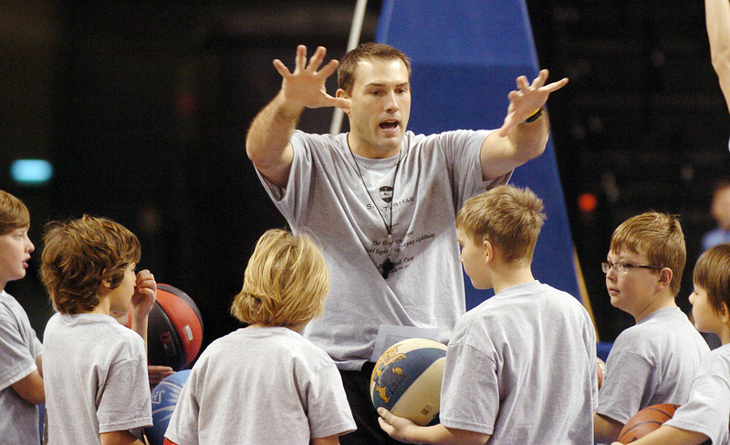 Beau Smith explains the next shooting drill to students during the basketball clinic before Saturday's Broomfield  Vs. Legacy girls and boys games at the 1stBank Center.<br /> January 8, 2011<br /> staff photo/David R. Jennings