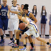Holy Family's Stephanie Giltner drives the ball down courtagainst Tyana Medema, Broomfield during Saturday's cross town game at Holy Family.<br /> <br /> January 29, 2011<br /> staff photo/David R. Jennings