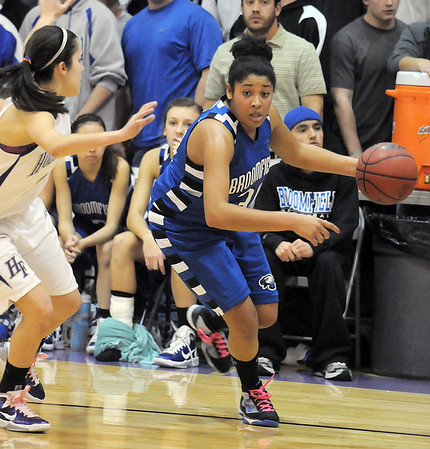Tyana Medema, Broomfield, drives to the basket against Carolina Gutierrez, Holy Family during Saturday's cross town game at Holy Family.<br /> <br /> January 29, 2011<br /> staff photo/David R. Jennings