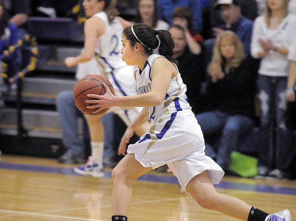 Megan Chavez, Holy Family, takes the ball down court against   Broomfield during Saturday's cross town game at Holy Family.<br /> <br /> January 29, 2011<br /> staff photo/David R. Jennings