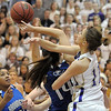 Holy Family's Taylor Helbig knocks the bal from Katie Nehf,   Broomfield during Saturday's cross town game at Holy Family.<br /> <br /> January 29, 2011<br /> staff photo/David R. Jennings