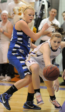 Holy Family's Kassandra Johannsen and Bre Burgesser, Broomfield fight for the ball at the line during Saturday's cross town game at Holy Family.<br /> <br /> January 29, 2011<br /> staff photo/David R. Jennings