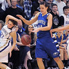 Broomfield's Katie Nehf collides with Sarah Talamates and Megan Chavez, Holy Family during Saturday's cross town game at Holy Family.<br /> <br /> January 29, 2011<br /> staff photo/David R. Jennings