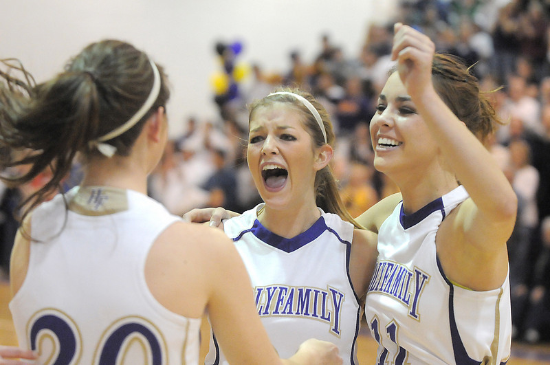 Holy Family's Stephanie Giltner, center, and Taylor Helbig celebrate the team defeating Broomfield with Abby Metzger after Saturday's cross town game at Holy Family.<br /> <br /> January 29, 2011<br /> staff photo/David R. Jennings