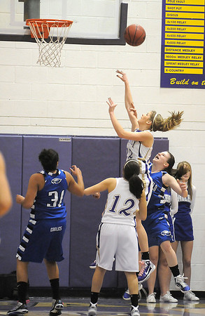 Holy Family's Stephanie Giltner shoots to the basket against Broomfield during Saturday's cross town game at Holy Family.<br /> <br /> January 29, 2011<br /> staff photo/David R. Jennings