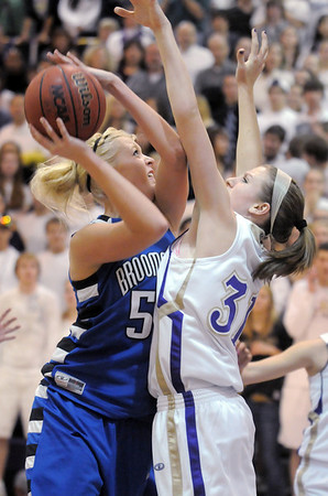 Bre Burgesser, Broomfield goes to the basket against Kassandra Johannsen, Holy Family during Saturday's cross town game at Holy Family.<br /> <br /> January 29, 2011<br /> staff photo/David R. Jennings