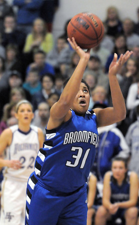 Broomfield's Tyana Medem goes for two against Holy Family during Saturday's cross town game at Holy Family.<br /> <br /> January 29, 2011<br /> staff photo/David R. Jennings