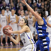 Holy Family's Megan Chavez under the basket against Broomfield's Brittney Zec during Saturday's cross town game at Holy Family.<br /> <br /> January 29, 2011<br /> staff photo/David R. Jennings