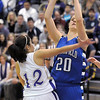 Meagan Prins, Broomfield, shoots over Megan Chavez, Holy Family  during Saturday's cross town game at Holy Family.<br /> <br /> January 29, 2011<br /> staff photo/David R. Jennings