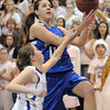 Broomfield's Katie Nehf goes for a layup past Holy Family's Sarah Talamantes during Saturday's cross town game at Holy Family.<br /> <br /> January 29, 2011<br /> staff photo/David R. Jennings