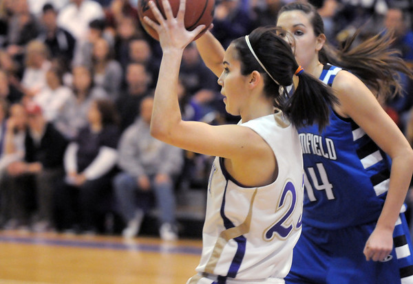 Holy Family's Carolina Gutierrez looks for an open player during Saturday's cross town game against Broomfield at Holy Family.<br /> <br /> January 29, 2011<br /> staff photo/David R. Jennings