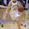 Holy Family's Taylor Helbig drives to the basket against  Broomfield  during Saturday's cross town game at Holy Family.<br /> <br /> January 29, 2011<br /> staff photo/David R. Jennings