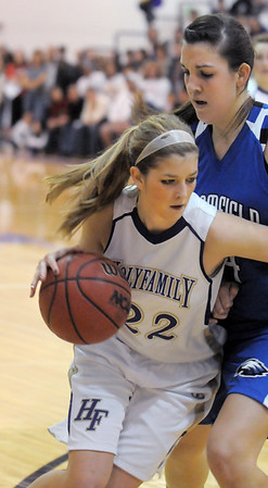 Holy Family's Stephanie Giltner drives the ball against Katie Nehf,   Broomfield during Saturday's cross town game at Holy Family.<br /> <br /> January 29, 2011<br /> staff photo/David R. Jennings