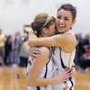 Holy Family's Stephanie Giltner and Taylor Helbig hug after defeating Broomfield 51-46 in Saturday's cross town game at Holy Family.<br /> <br /> January 29, 2011<br /> staff photo/David R. Jennings