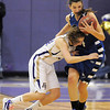 Holy Family's Sarah Talamantes collides with Broomfield's Katie Nehf during Saturday's cross town game at Holy Family.<br /> <br /> January 29, 2011<br /> staff photo/David R. Jennings