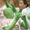 Holy Family fan dressed as a greenman dances in the stands during     Saturday's cross town girls game against Broomfield at Holy Family.<br /> <br /> January 29, 2011<br /> staff photo/David R. Jennings
