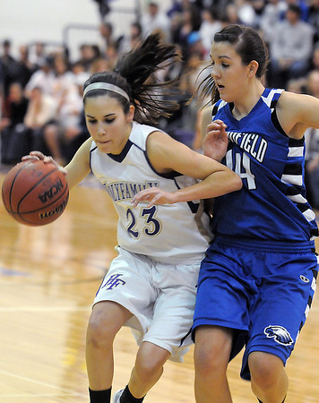 Holy Family 's Carolina Gutierrez drives to the basket against  Broomfield's Katie Nehf during Saturday's cross town game at Holy Family.<br /> <br /> January 29, 2011<br /> staff photo/David R. Jennings