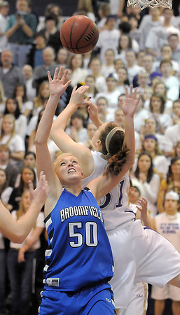 Bre Burgesser, Broomfield and Kassandra Johannsen, Holy Family , battle for a rebound  during Saturday's cross town game at Holy Family.<br /> <br /> January 29, 2011<br /> staff photo/David R. Jennings