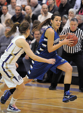 Broomfield's Katie Nehf drives the ball down court against Taylor Helbig, Holy Family  during Saturday's cross town game at Holy Family.<br /> <br /> January 29, 2011<br /> staff photo/David R. Jennings