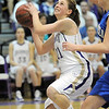 Holy Family 's Sarah Talamantes goes to the bakset against Bre Burgesser, Broomfield during Saturday's cross town game at Holy Family.<br /> <br /> January 29, 2011<br /> staff photo/David R. Jennings