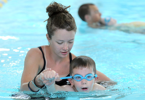 Swim instructor Alex Van De Boogaard works with Merik Howell, 4, on moving his arms while swimming during the beginning swim lessons at the Broomfield Community Center pool on Wednesday.<br /> <br /> June 22, 2011<br /> staff photo/David R. Jennings