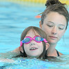 Swim instructor Alex Van De Boogaard works with Taryn Howell, 4, getting used to the water while swimming during the beginning swim lessons at the Broomfield Community Center pool on Wednesday.<br /> <br /> June 22, 2011<br /> staff photo/David R. Jennings