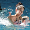 Swim instructor Leigha McCoy works with Maggie Burke, 26 months-old,  during the beginning swim lessons at the Broomfield Community Center pool on Wednesday.<br /> <br /> June 22, 2011<br /> staff photo/David R. Jennings