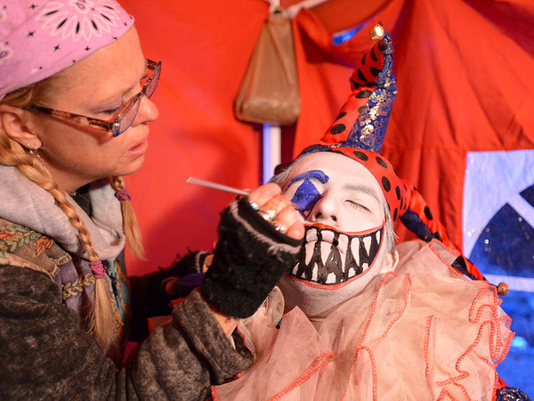 Frightmare Compound makeup artist Jackie Stemarie, left, hand paints the complex clown face for actor Rodrigo Fernandez before the haunted house opens on Friday night.<br /> October 5, 2012<br /> staff photo/ David R. Jennings