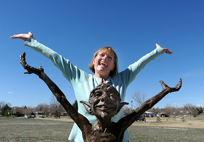 """be0401heart19mil.jpg Fran Milner, Heart of Broomfield Arts winner poses with the the Art for Awhile scupture, """"Green Thumb"""" next to the Mamie Doud Eisenhower Public Library. March 24, 2012  staff photo/ David R. Jennings"""
