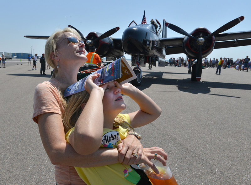be0830airshow01.JPG Sarah Higgins and her daughter Anna, 10, from Boulder, watch airplanes performing stunts during Saturday's Rocky Mountain Airshow 2012 at Rocky Mountain Metropolitan Airport. <br /> <br /> August 26, 2012<br /> staff photo/ David R. Jennings