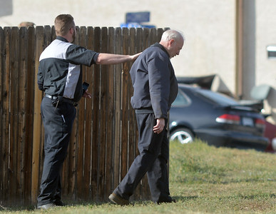 An Employee of East of Sweden reaches out to comfort the owner at the scene of a fatal shooting at the business at 155 Commerce St. in Broomfield. October 12, 2012 staff photo/ David R. Jennings