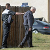 An Employee of East of Sweden reaches out to comfort the owner at the scene of a fatal shooting at the business at 155 Commerce St. in Broomfield.<br /> October 12, 2012<br /> staff photo/ David R. Jennings