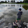 Michael Saunders, 12, fishes from the rocks during the Optimists Club Fishing Derby on Saturday at the Trails Park.<br /> August 25, 2012<br /> staff photo/ David R. Jennings