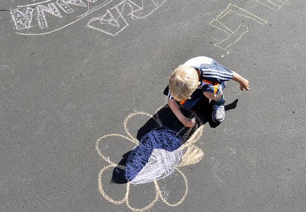 be0603trails17.jpg Scott Hansen, 6, makes a chalk drawing during the 11th Annual Trail Adventure in the Westlake neighborhood on Saturday.<br /> June 2, 2012 <br /> staff photo/ David R. Jennings