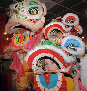 be0126chinese03.jpg Baby lion dancers Amy Hatchett, 6, front, and Gabbi Kovalenko, 10, right, with the yellow lion, Doug Sexton, watch the red lion perform a traditional dance for Chinese New Year at United Chinese Restaurant on Monday. For more photos please see www.broomfieldenterprise.com January 23, 2012 staff photo/ David R. Jennings