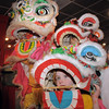 "be0126chinese03.jpg Baby lion dancers Amy Hatchett, 6, front, and Gabbi Kovalenko, 10, right, with the yellow lion, Doug Sexton, watch the red lion perform a traditional dance for Chinese New Year at United Chinese Restaurant on Monday.<br /> For more photos please see  <a href=""http://www.broomfieldenterprise.com"">http://www.broomfieldenterprise.com</a><br /> January 23, 2012<br /> staff photo/ David R. Jennings"