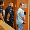 Lawrence Crouch, 62, is escorted out of the courtroom after appearing before District Court Judge Patrick Murphy where he was charged with first-degree murder in the shooting death of Mary McGrath at East of Sweden Saab repair shop on October 12.<br /> October 18, 2012<br /> staff photo/ David R. Jennings