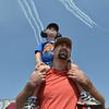 Micah Epperson and his son Gavin, 3, from Thornton, watch the warbirds on parade performance during Saturday's Rocky Mountain Airshow 2012 at Rocky Mountain Metropolitan Airport. <br /> <br /> August 26, 2012<br /> staff photo/ David R. Jennings