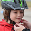 Beau Noland, 8, has his helmet adjusted by a volunteer during the Bicycle Skills  Course sponsored by the Children's Health Advocacy Institute in the Bay Aquatic Park parking lot on Saturday.<br /> October 13, 2012<br /> staff photo/ David R. Jennings