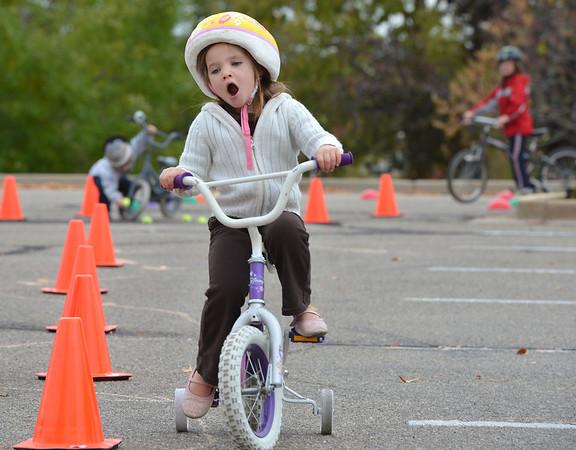 Mollie Skibinski, 4 1/2, yawns as she rides her bicycle through the course during the Bicycle Skills  Course sponsored by the Children's Health Advocacy Institute in the Bay Aquatic Park parking lot on Saturday.<br /> October 13, 2012<br /> staff photo/ David R. Jennings