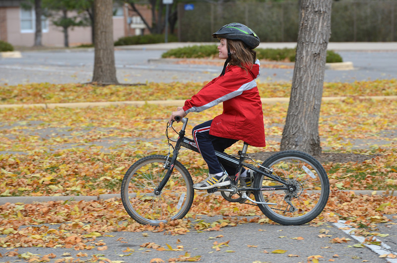Beau Noland, 8, rides his bicycle through the leaves during the Bicycle Skills  Course sponsored by the Children's Health Advocacy Institute in the Bay Aquatic Park parking lot on Saturday.<br /> October 13, 2012<br /> staff photo/ David R. Jennings