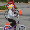 Mollie Skibinski, 4 1/2, ride her bicycle trough the course during the Bicycle Skills  Course sponsored by the Children's Health Advocacy Institute in the Bay Aquatic Park parking lot on Saturday.<br /> October 13, 2012<br /> staff photo/ David R. Jennings