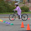 Valera Noland, 6, learns how to stop during the Bicycle Skills  Course sponsored by the Children's Health Advocacy Institute in the Bay Aquatic Park parking lot on Saturday.<br /> October 13, 2012<br /> staff photo/ David R. Jennings