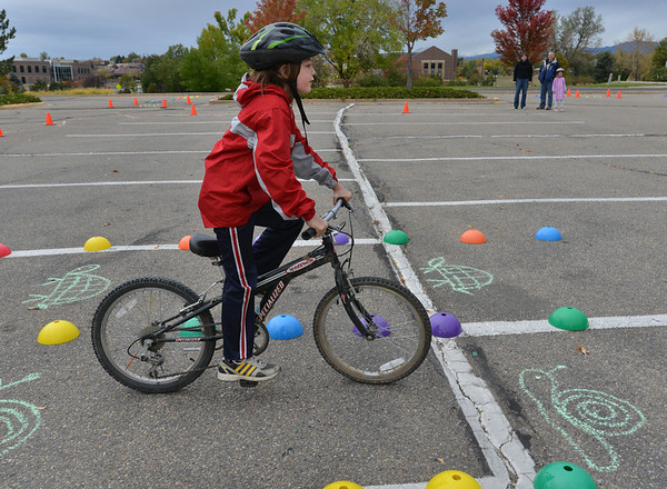 Beau Noland, 8, rides his bicycle slowly through the course during the Bicycle Skills  Course sponsored by the Children's Health Advocacy Institute in the Bay Aquatic Park parking lot on Saturday.<br /> October 13, 2012<br /> staff photo/ David R. Jennings