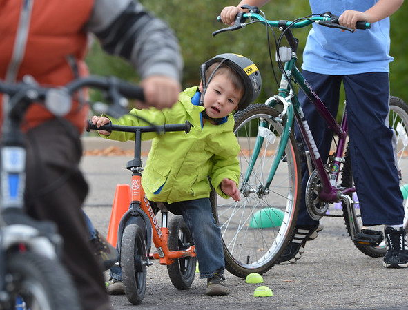 Oliver Wear, 2 1/2, waits for his turn to ride through the course during the Bicycle Skills  Course sponsored by the Children's Health Advocacy Institute in the Bay Aquatic Park parking lot on Saturday.<br /> October 13, 2012<br /> staff photo/ David R. Jennings