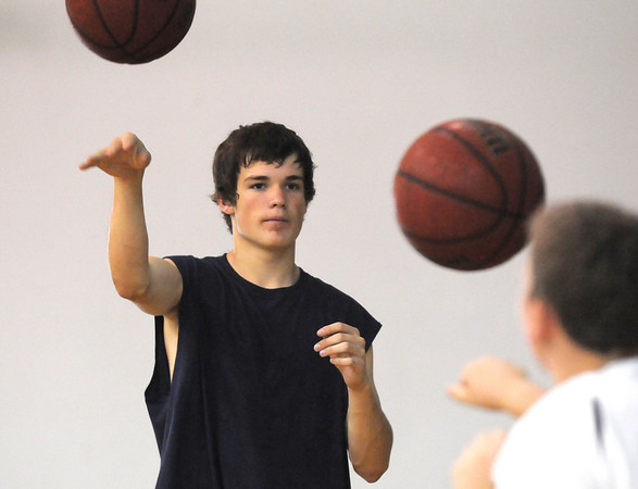 BE0610CAMP04<br /> Jake Morris, 14, works on his passing skills at the Big Blue Basketball Camp held by coach Terrance Dunn at Broomfield High School on Tuesday.<br /> <br /> June 8, 2010<br /> Staff photo/ David R. Jennings