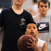 BE0610CAMP05<br /> Tin Dinh, 12, eyes the basket while working on his shooting skills at the Big Blue Basketball Camp held by coach Terrance Dunn at Broomfield High School on Tuesday.<br /> <br /> June 8, 2010<br /> Staff photo/ David R. Jennings